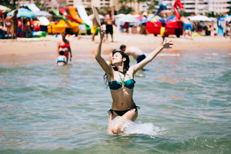 Happy Young Bikini Woman Playing In Sea
