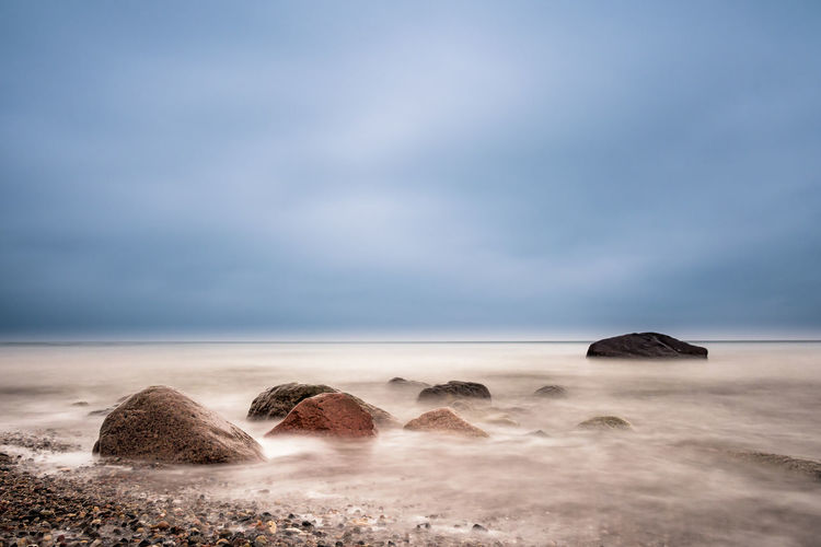Stones on shore of the Baltic Sea. Baltic Sea Beach Boulders Clouds And Sky Coast Dramatic Sky Evening Holiday Landscape Nature Nature No People Ocean Outdoors Rocks Sea Shore Sky Stones Tourism Travel Vacation