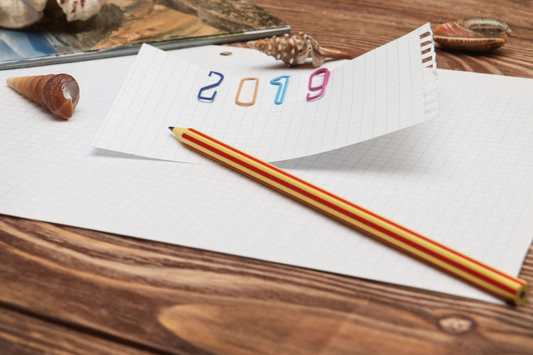 Still Life Table Paper Wood - Material Indoors  Pencil No People Text High Angle View Writing Instrument Pen White Color Art And Craft Communication Education Creativity Number Blank Message Plan Of Action 2019 Plans For 2019 Travelling