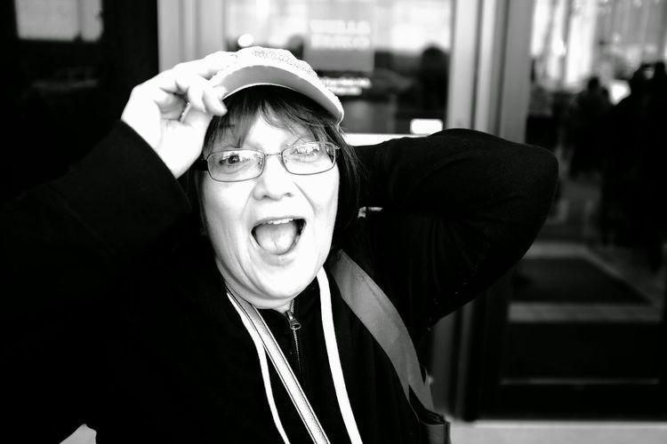 Close-up portrait of cheerful senior woman