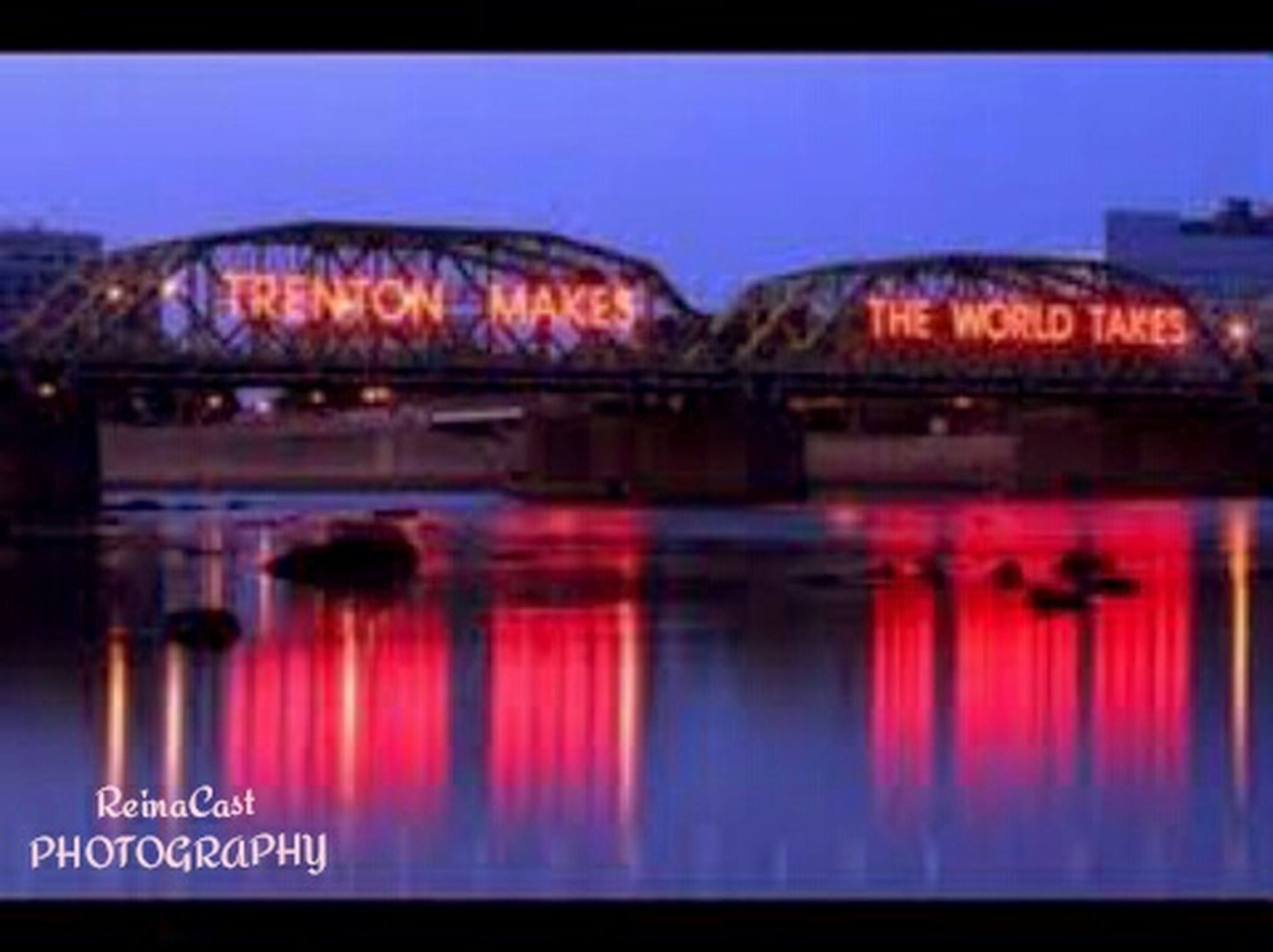 water, reflection, illuminated, architecture, waterfront, built structure, river, clear sky, connection, bridge - man made structure, arch, night, bridge, building exterior, transportation, lake, no people, sky, outdoors, red
