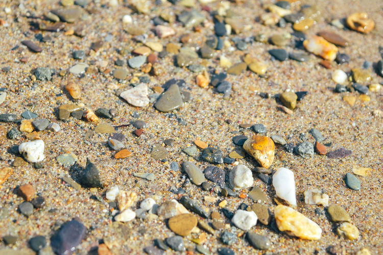 High angle view of stones on sand