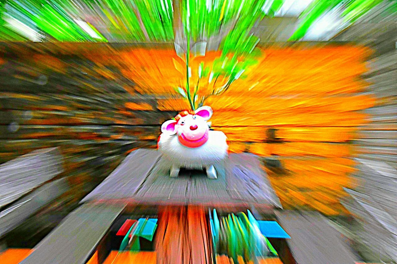 blurred motion, motion, no people, creativity, close-up, multi colored, art and craft, indoors, representation, craft, decoration, arts culture and entertainment, speed, day, focus on foreground, toy, paint, green color, chinese new year, festival