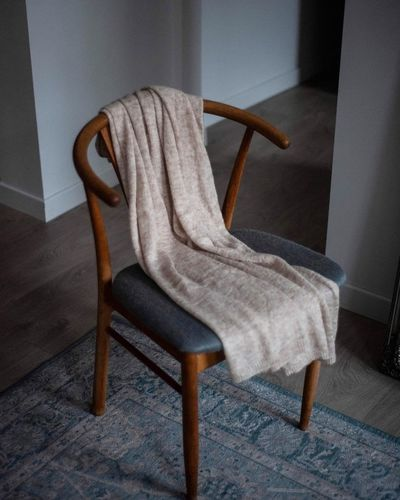 Empty chair on floor at home