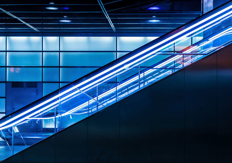 Architecture Reflection Night Motion Escalator Modern Underground Station Blue Illuminated Neon Lights Transportation Public Transportation Indoors  Futuristic No People Glass - Material Neon Life Mobility In Mega Cities This Is Queer HUAWEI Photo Award: After Dark Capture Tomorrow 17.62°