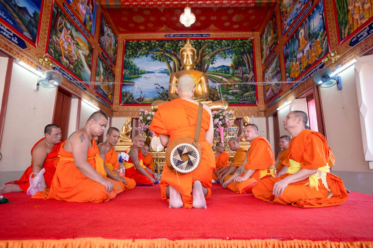 Buddha Day Human Representation Indoors  Men Ordain People Priest Religion Sitting Statue Togetherness