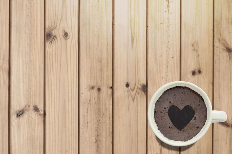 High angle view of coffee cup on wood