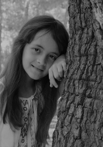 Growing and blooming Portrait Looking At Camera Child One Person Tree Trunk Childhood Girls Trunk Lifestyles Leisure Activity Innocence Smiling Front View Tree Real People