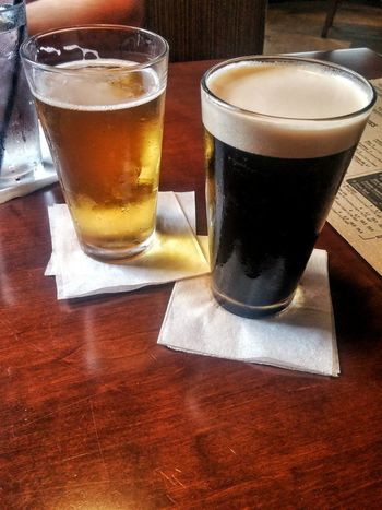 Draft beer at a local tavern. Draft Beer Tavern Drinks Dark Beer Irish Beer Beer Foam Date Night Dinner And Drinks Dinner With My Wife Cold Drink Beer The Good Life