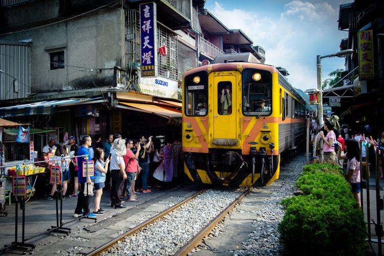 ASIA Building Exterior City Cute Histroic Land Vehicle People Public Transportation Rail Railway S Signature Sky Snap Street Street Photography Streetphotography Taipei Taiwan Train - Vehicle Tranditional Transportation Travel Yellow