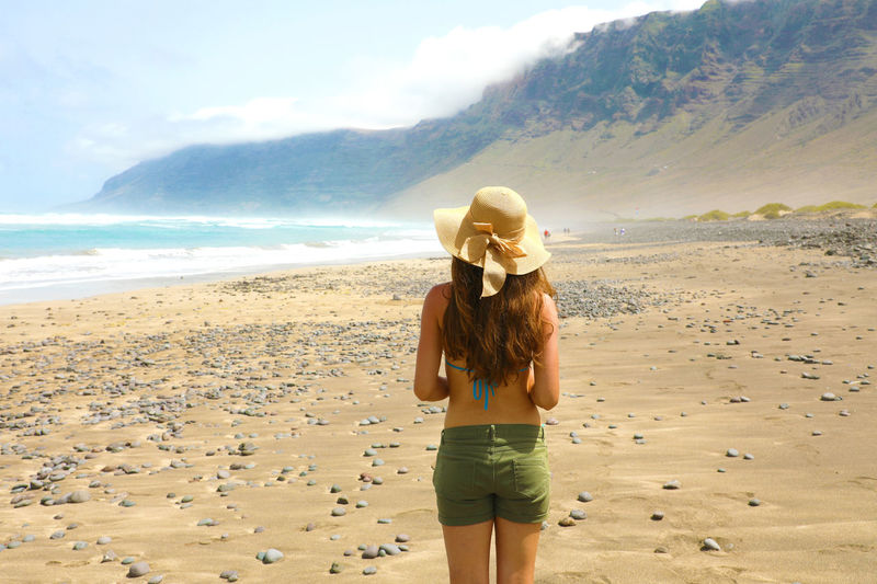 Back view woman in Lanzarote, Spain Beautiful Nature Rear View Beach Beachphotography Beautiful Woman Fantastic Beach Leisure Activity One Person Sea Standing Vacations