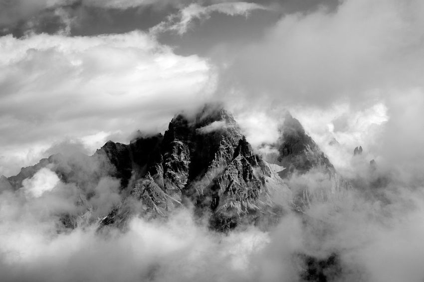 Mt. Cristallo and Piz Popena, two of the most iconic mountains above Cortina d'Ampezzo, shot from Punta Nera in the Sorapiss range. Cortina D'Ampezzo Dolomites, Italy Alpinism Blackandwhite Clouds And Sky Cristallo Landscape Mountain Mountains And Sky Nature Weather