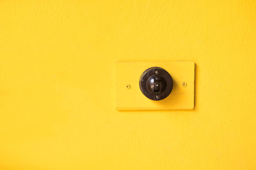 Yellow No People Electricity  Wall - Building Feature Copy Space Architecture Light Switch Switch Knob Push Button Power Supply Surface Level Home House Building Exterior Interior Design Blackandwhite Control Bright Close-up Empty