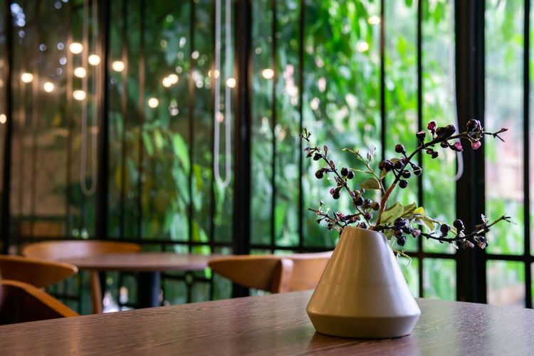 Great corner in the cafe. Coffee Shop Food And Drink Cafe Chair Close-up Decoration Decorative Art Flower Arrangement Focus On Foreground Freshness Indoors  Luxury No People Plant Restaurant Seat Setting Table Vase Window Wood - Material