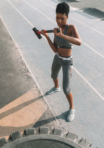 Gym One Person Lifestyles Sport Leisure Activity Black Woman Exercising Exercise Strength Strength Training Fit Woman Fitness Hammer Training Work Gym