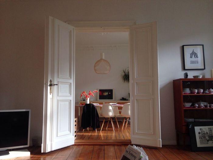 View of dining room through open doors