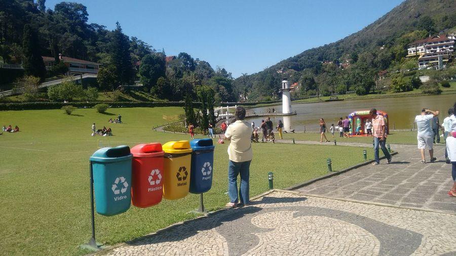 Recicle Reciclagem Lixeiras Reciclando Recicle Palacio Quitandinha Petrópolis Farol Tree Water Sky Grass Area Large Group Of People The Art Of Street Photography