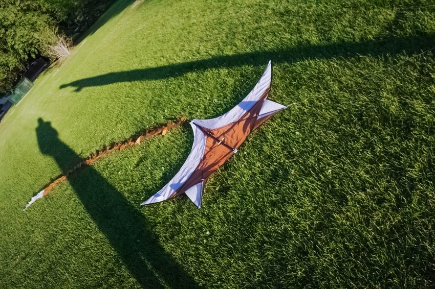 """""""Metaphor for a failed attempt to recapture our fading youth"""" (2018) Grass Area Denver Colorado  Outdoor Photography Daylight Photography Summertime Summer Views Park - Man Made Space Kite Flying Kites Downed Kite Shadows And Sunlight Shadows Sunlight Sunny Day"""