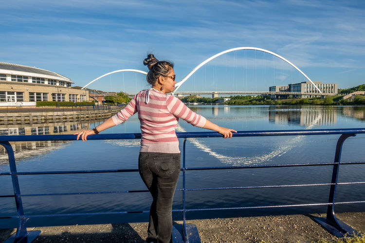 Stockton On Tees Teesside County Durham River Tees Tees Infinity Bridge Full Length One Person Lifestyles Water Leisure Activity Casual Clothing Real People Day Standing Front View Nature Sunlight Young Adult Built Structure Architecture Sky Women Outdoors Human Arm