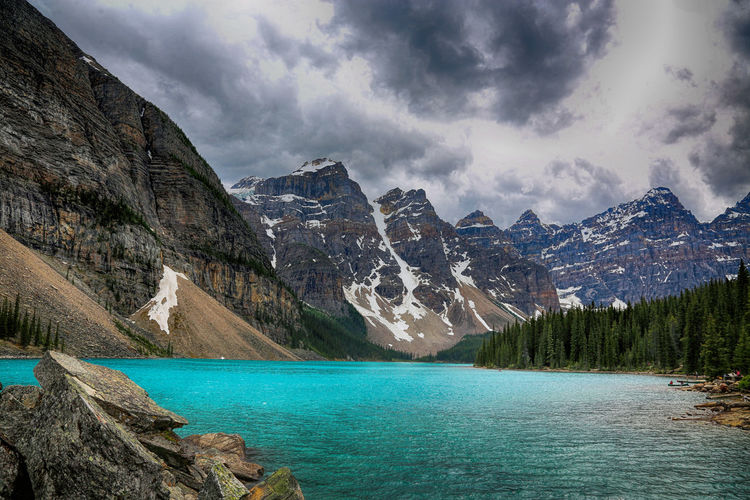 Lake Moraine, Canada Scenics - Nature Water Beauty In Nature Mountain Cloud - Sky Lake Sky Tranquil Scene Nature Mountain Range Tranquility Tree Non-urban Scene Idyllic Day Land Turquoise Colored No People Outdoors Formation Mountain Peak Lake Moraine LAKE MORAINE ALBERTA CANADA Glacier Melt Water