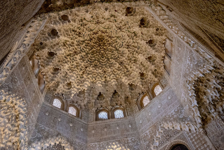 interior of Alhambra, Granada, Spain Alhambra Alhambra De Granada  Interior Spain Architecture SPAIN Arabic Style Architecture History The Past Low Angle View No People Built Structure Arch Old Day Building Exterior Building Religion Place Of Worship Ancient Spirituality Belief Outdoors Nature Ceiling Ornate