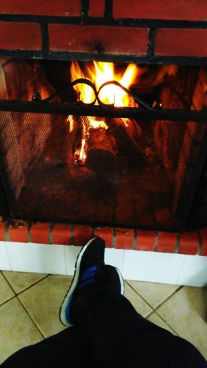 Always Be Cozy Low Section Shoe One Person Human Leg Indoors  People Human Body Part Adult Day Fireplace Time Fireplace Fireplace Warmth Wood - Material Fire Warmth Happiness Lifestyles Photooftheday Photography