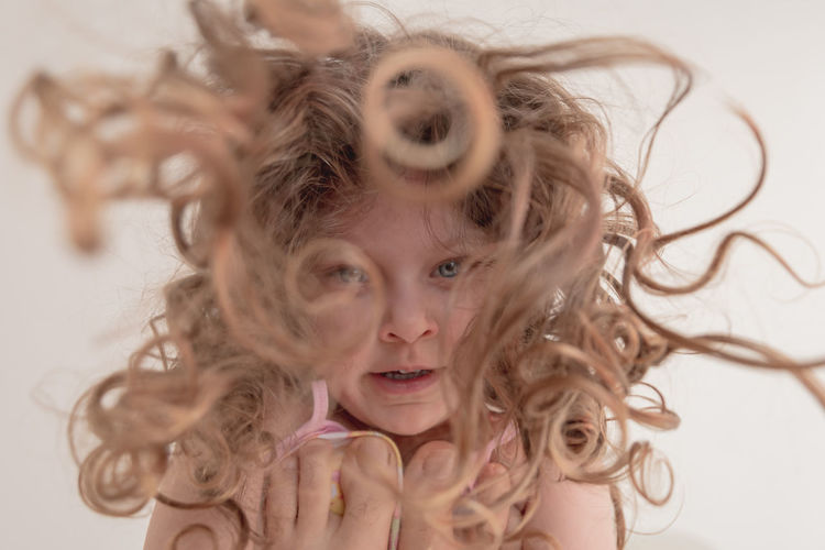 Low angle view of girl with messy hair