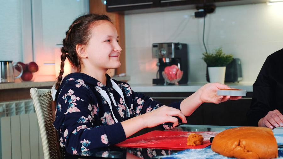 Girl holding ice cream in restaurant