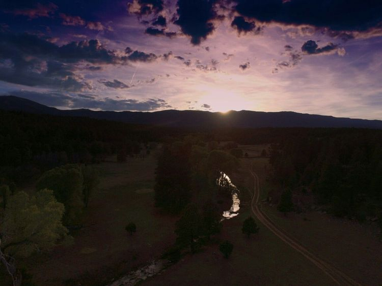 Sunset Forest Mountain High Angle View Sun Landscape Outdoors No People Nature Sky Tree Astronomy Newmexicomountain Newmexicophotography Newmexicoskys New Mexico Skies NewMexicoTRUE New Mexico True Newmexicoskies Tranquil Scene New Mexico, USA