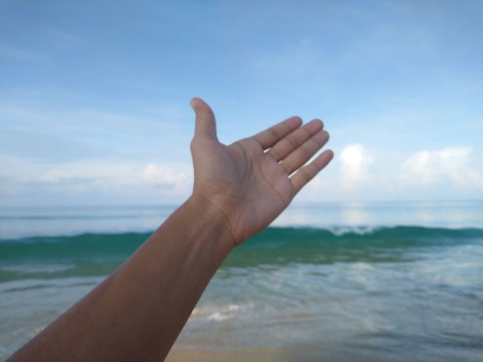 handful Human Hand Manicure Beach Sea Water Body Part Business Finance And Industry Fingernail Hand Sky