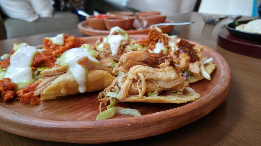 Close-up of mexican food served on table