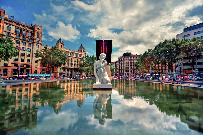 Reflection Water Cloud - Sky Outdoors Architecture Vacations City Building Exterior Nikon D800 Day Barcelona Plazacatalunya Catalunya Plaza Centre City SPAIN Spaın Spain♥ Spain ✈️🇪🇸 Barcellona Fountain Colors Monument