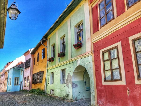 Medieval towns Sighisoara-Romania Street Photography Archway Doorsandwindows Historical Building Medieval Town Eastern Europe Quaint Places EyeEm Gallery EyeEm Best Shots Facades Colorful Houses Building Exterior Architecture Built Structure Building Sky Window Residential District No People Day Clear Sky House Outdoors Street Old