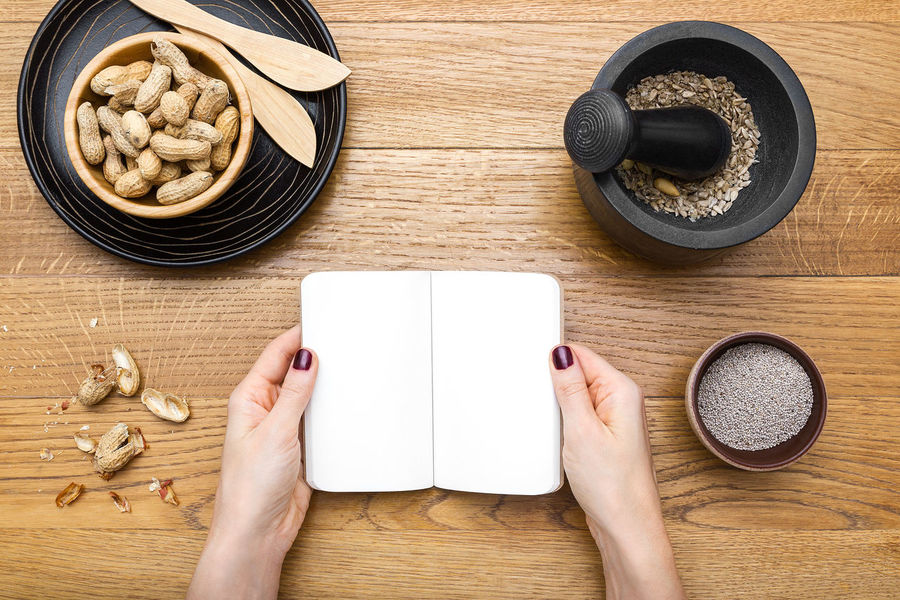 Female hands holding a planner on a wooden tabletop with healthy snacks Directly Above Female Hands Food Food And Drink Freshness Healthy Food Human Hand Mockup One Person Peanuts Planner Table Tabletopphotography Wooden Tabletop
