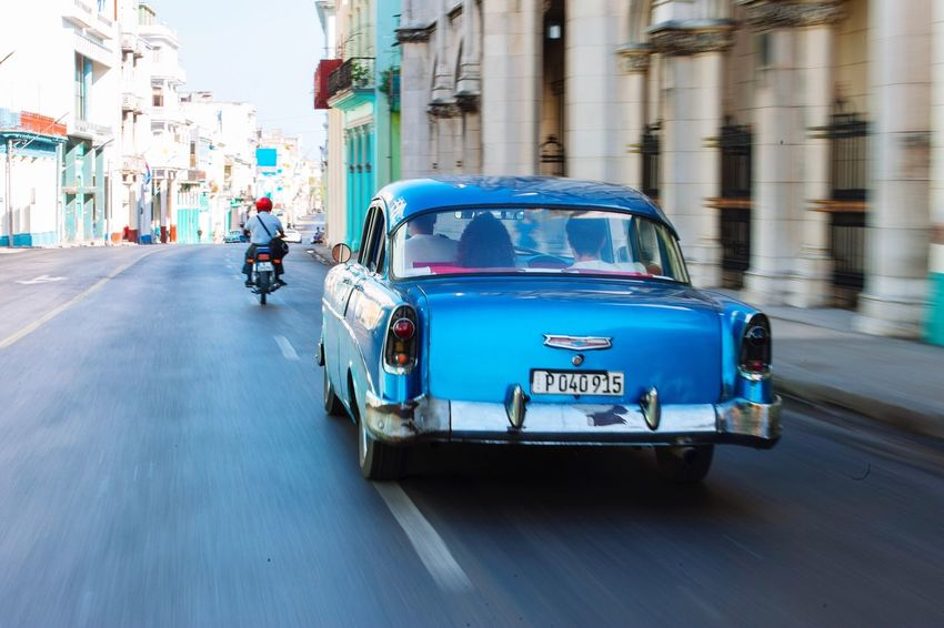 Taking a ride in Havana , Cuba Car Transportation Mode Of Transport Building Exterior Blue Day Road City Architecture Street Streetphotography Panning Cuban Cars Lifestyles Connected By Travel Postcode Postcards Nikon City Old Sun The Week On EyeEm Eye4photography  City Life