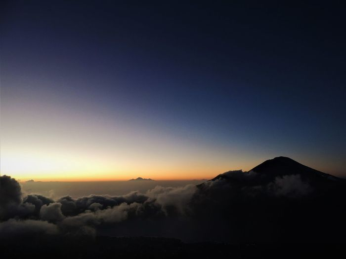 The stunning view of the sunrise at the top of Mount Batur, Bali, Indonesia. August 2016. Bali Bali, Indonesia Exploring INDONESIA Nikon Sky And Clouds Sunrise_Collection Trekking Beauty In Nature Day Gabiandbali Gabiandindonesia Inspiring Landscape Mountain Nature No People Outdoors Scenics Sky Sun Sunrise Sunrise And Clouds Tranquility Volcano Go Higher