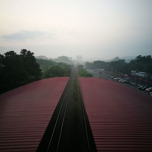 Travel Photography Travelbytrain Tranquility Trainstation Train RideBusiness Finance And Industry Trains & Railroad Foggy Morning Morning Mist The Way Forward Outdoors Ukmbangi Longwayride Tree Red No People Shadow Day Futuristic Sky Architecture Politics And Government