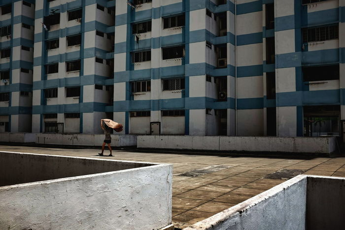 Everybodystreet Streetphoto_color Streetphotography Street Photography People FUJIFILM X100S Voiddeck Residential Building Boy Superhero Cape  Blue Building Housing Estate HDB Flats Sunny Afternoon Street Life Street Feel The Journey