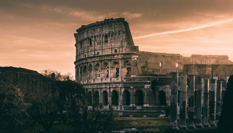 Colosseum in rome at sunrise History Architecture The Past Ancient Built Structure Sky Old Ruin Travel Destinations Building Exterior Ancient Civilization Cloud - Sky Nature Tourism Travel Arch Sunset No People Archaeology Architectural Column Ruined