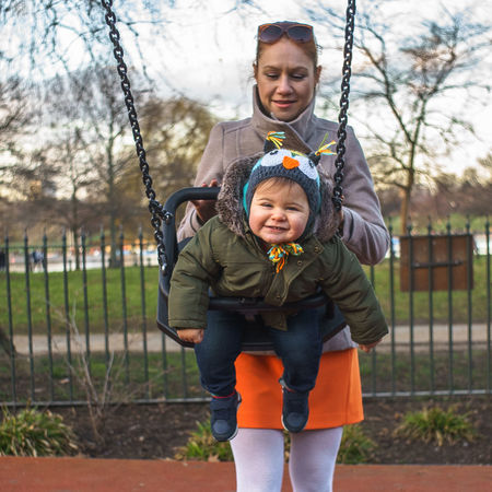 Moments Swinging Adult Cheerful Childhood Day Family With One Child Front View Happiness Hyde Park Lifestyles Looking At Camera Love Mom Nature Outdoors People Portrait Real People Smiling Swing Toddler  Toddlerlife Togetherness Warm Clothing