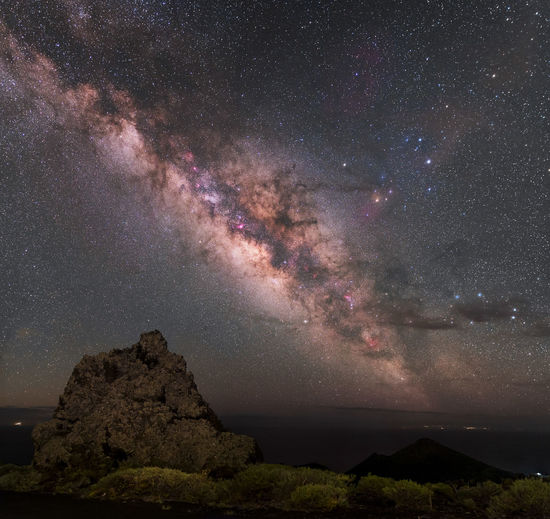 Volcanic landscape under a mantle of stars from south of La Palma island, Spain. The clouds were slow to leave, but finally the stars shone that night. Panoramic image composed by 8 photos. Astronomy Astrophotography Astrophotography Astronomy Black Cosmos Dark Dark_nature Landscape Landscape_photography Milky Way Milkyway Nature Night Night Lights Night Photography Night Sky Nightphotography Rock Rock - Object Sea Sky Space Star Stars Universe
