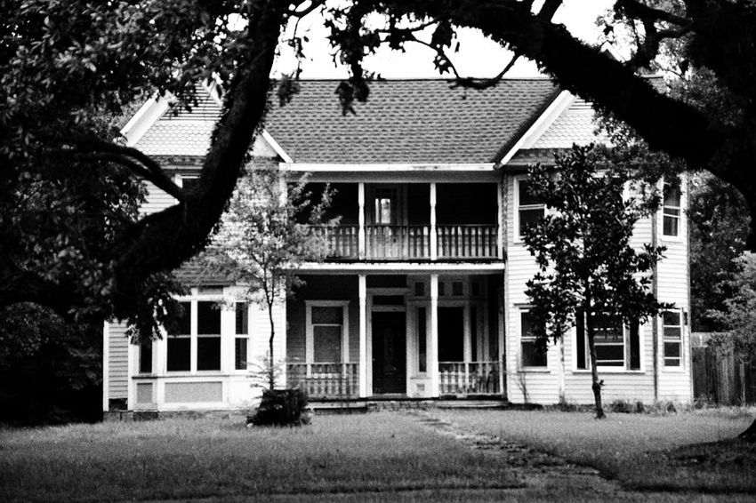 a classic Building Exterior Tree Architecture Built Structure Façade Outdoors Window Day No People South Louisiana Neglected Architecture Architecture Residential Building House Black And White Collection  Black & White Photography Two Storied House