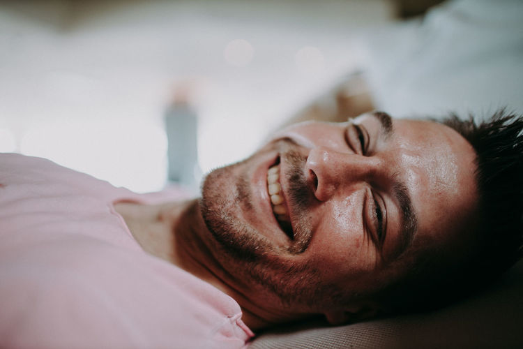 Portrait of man lying on bed