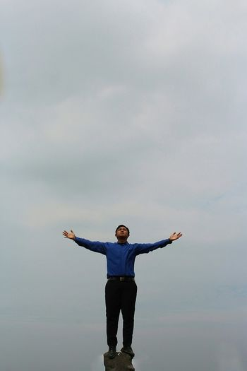 Full length of man standing against sky