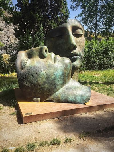 Igor Mitoraj exhibits Italy Faces Sculpture Tree Sunlight No People Shadow Outdoors Statue Day Nature Mammal