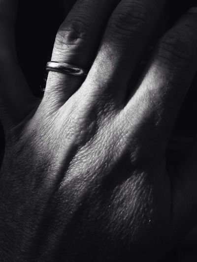 Cropped Hand On Man With Wedding Ring
