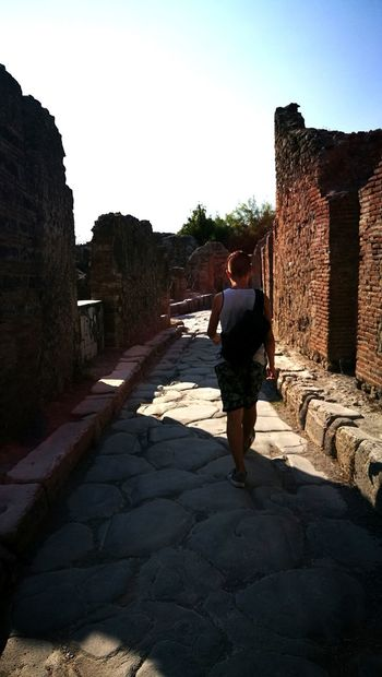 One Man Only Rear View Only Men One Person Adult Adults Only People Men Outdoors Day Sky Pompeii Ruins Pompei Scavi Ancient Roman Road Walking Street Tranquility Vacations Huaweii P9 HuaweiP9 Adventures In The City