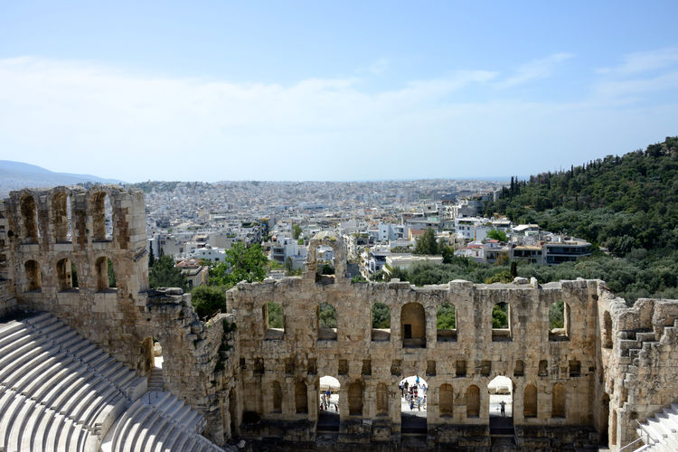 panoramic view from the Acropolis of the ruins of colosseum and cityscape Architecture Building Exterior Built Structure Sky City History Travel Destinations The Past Building Residential District High Angle View No People Ancient Day Travel Town Tree Old Ruin Outdoors Cityscape Ancient Civilization Archaeology Acropolis, Athens Panoramic View Athens, Greece Theatre Greek Culture Tourism Destination Colosseum Panorama Cityscape
