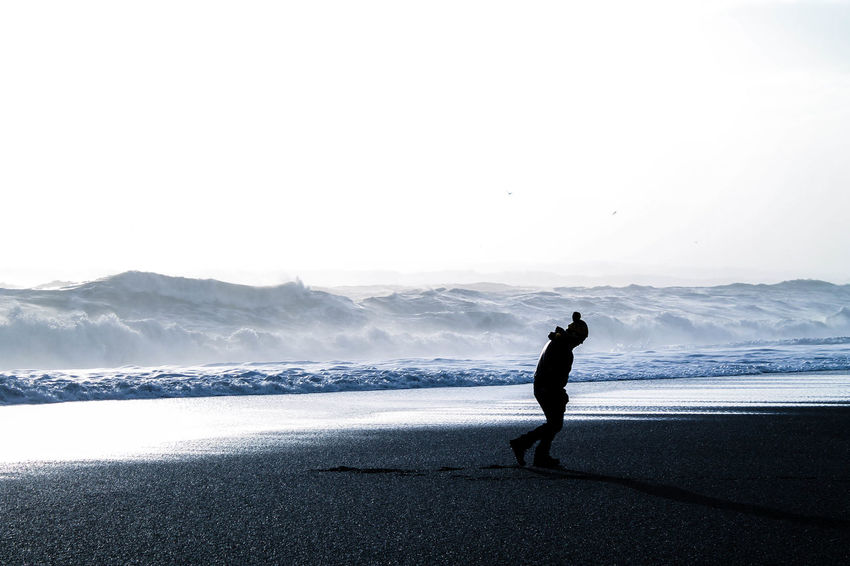 Backpacking Beach Beachphotography Beauty In Nature Blacksand Blacksandbeach Iceland Men Nature Ocean One Person Outdoors Paradise Real People Sea Shadow Silhouette Silhouette_collection Silouette & Sky Sky Travelling Water Wave