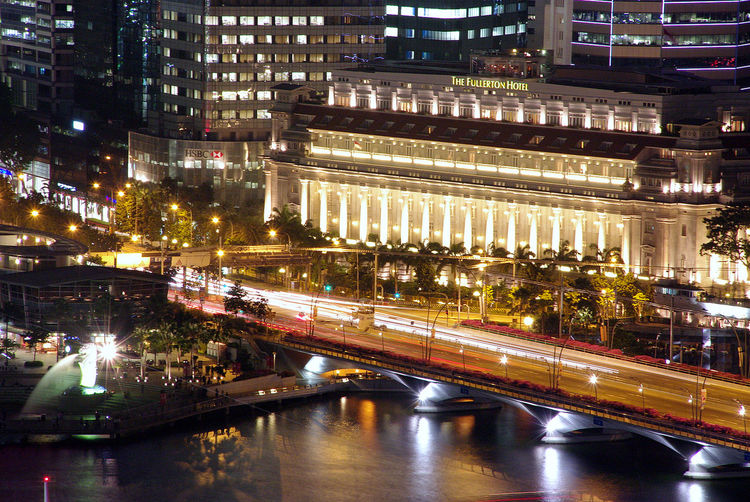 Singapore, 2009 view of Fullerton Hotel from Pan Pacific Architecture Bridge Long Exposure Building Exterior Building Story Built Structure Canal City City Life City Street Connection A Room With A View Engineering Illuminated Modern Night Office Building Outdoors Merlion Tourism Transportation Travel Destinations Water Waterfront Fullerton